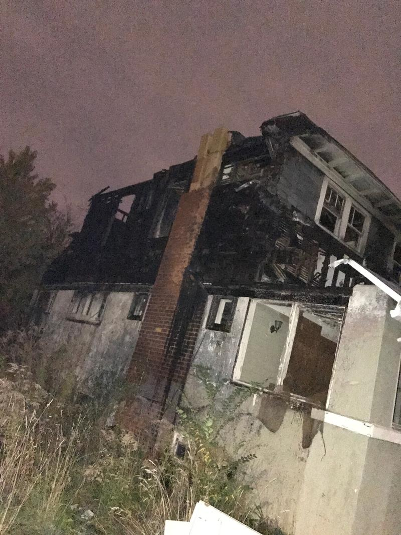 side view of a burned-out crafstman-style home.
