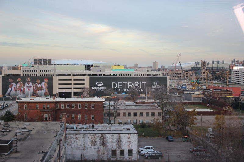 Little Caesars Arena Construction site in downtown, with a Pistons banner
