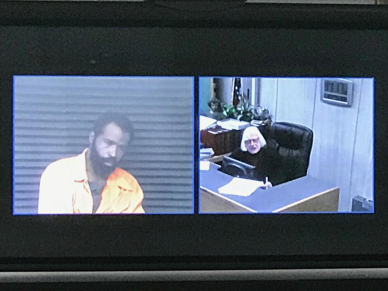 DeAngelo Lamar Davis (left) pleaded not guilty to six total murder and weapons charges. He was arraigned Friday at the 34th district court in Romulus by retired judge Vesta Svenson (right)