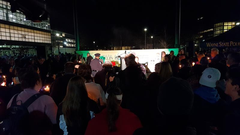 Mourners gather in Gullen Mall, at the center of Wayne State University's campus to pay respects to Officer Collin Rose.
