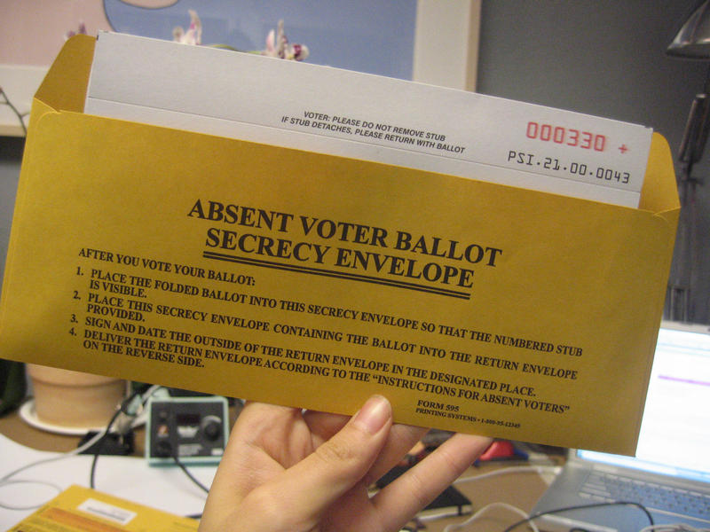 An absentee ballot in an envelope.