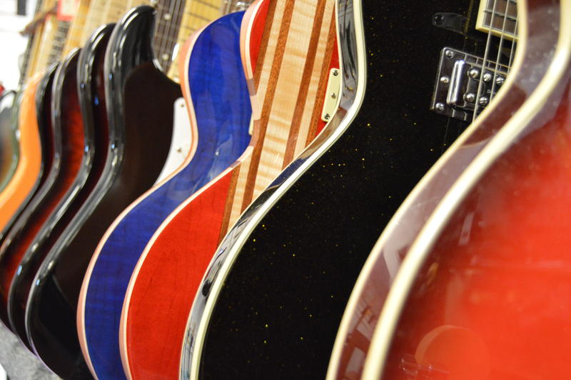 A rainbow of colors and styles of guitars.
