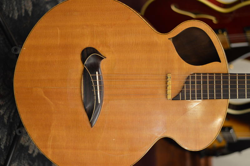 An Art Nouveau inspired acoustic guitar.