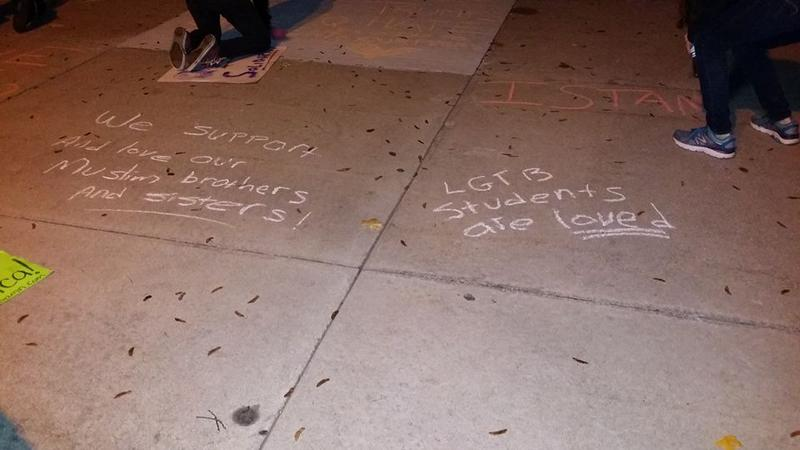 Protesters chalked anti-hate messages outside Royal Oak Middle School, after reported incidents of race-based bullying there.
