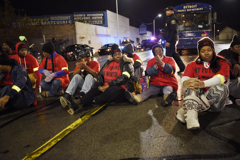 Demonstrators block traffic in Detroit early Tuesday morning.