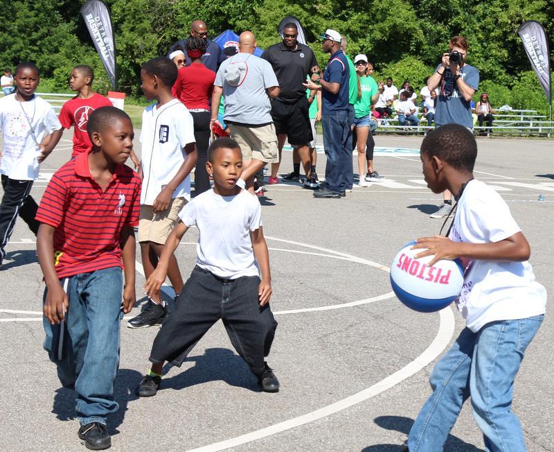 three boys playing basketball