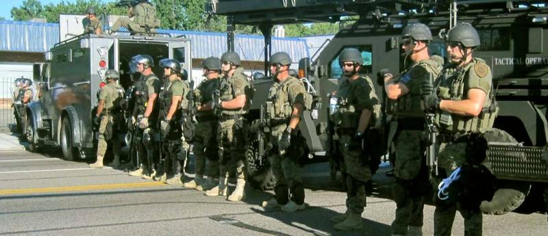 Police line up in Ferguson, Missouri in preparation for protests. The St. Louis suburb was rocked by demonstrations for 17 days because of a police shooting of an unarmed black man.