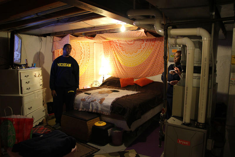 Charles and Dana turned the basement of their apartment into their room.