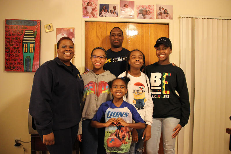 The Banks family in their new Ann Arbor apartment.