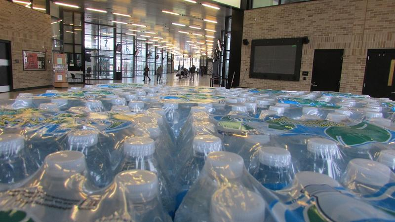 Stacks of bottled water sit in Flint's MTA downtown bus station