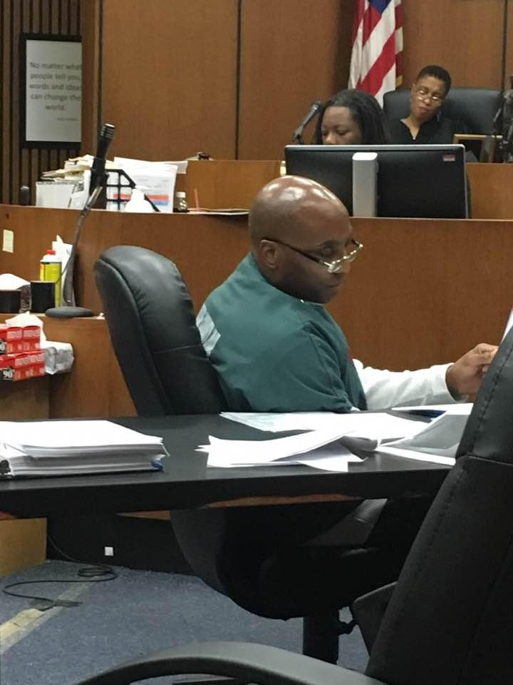 Lamarr Monson takes notes in court during final arguments to overturn his murder conviction.