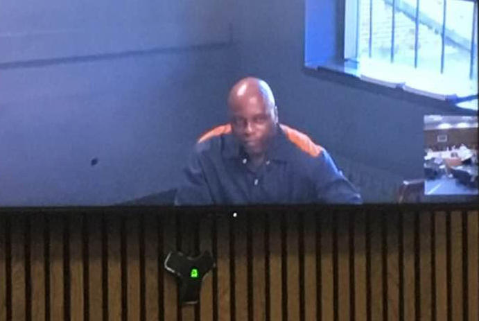 Renard Johnson appears in court for resentencing via videoconference.