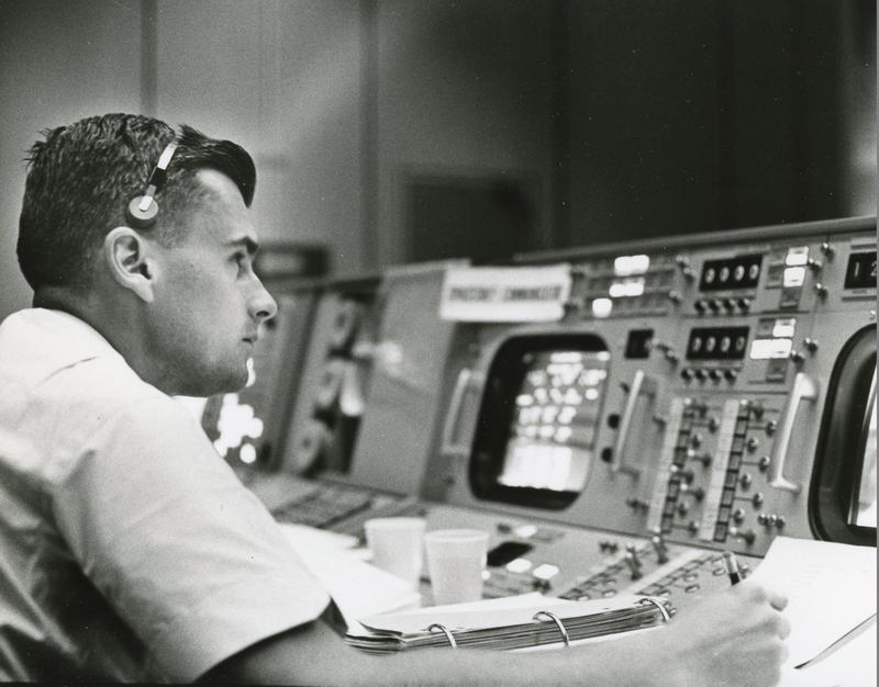 Roger Chafee in May 1965 at a console in NASA's Mission Operations Control Room in the Mission Control Center (MCC) in Houston during a Gemini simulation.