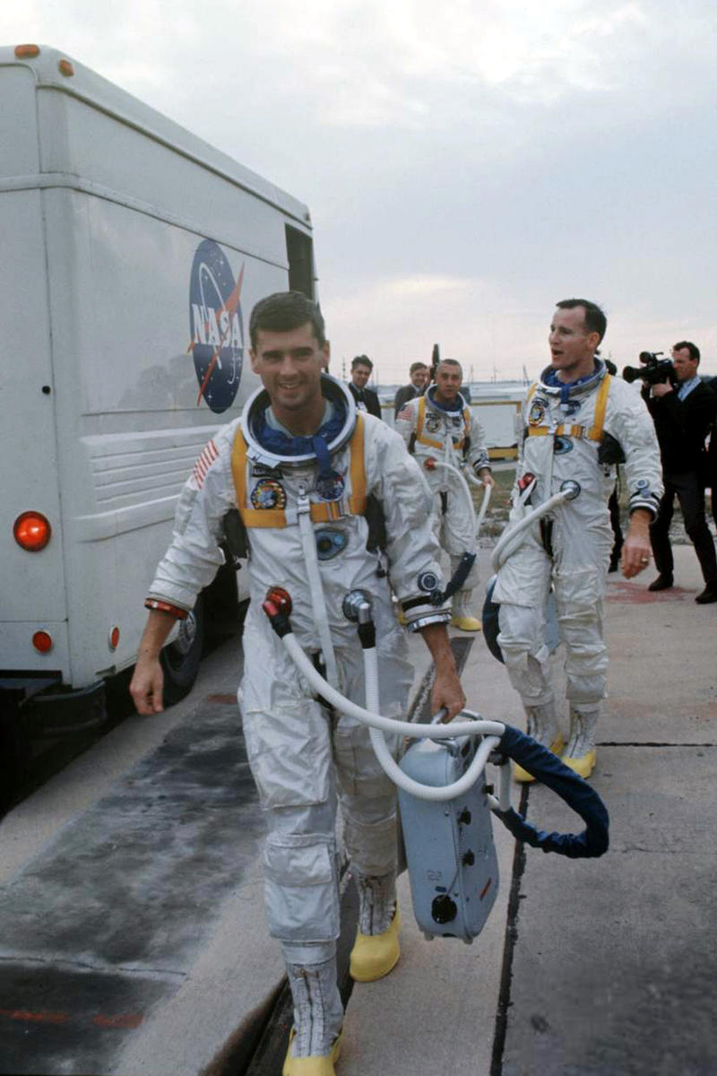 The Apollo 1 crew leave the astronaut transfer van on January 17, 1967. In front is Roger, followed by crewmates Ed White and Gus Grissom.