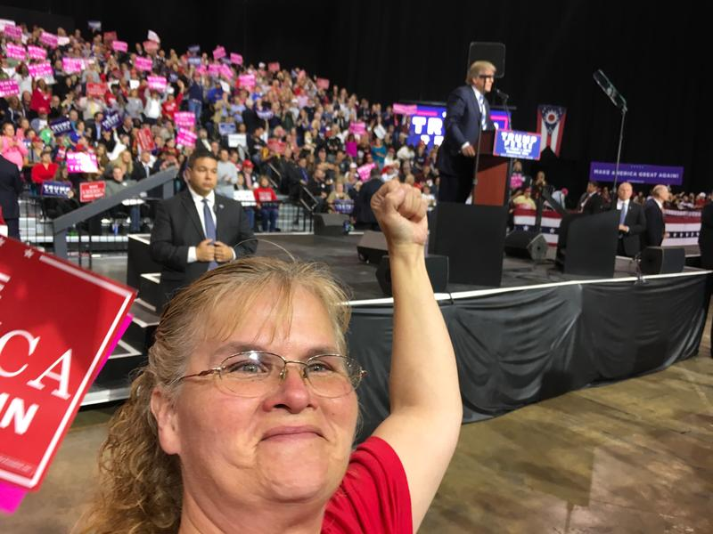 Renee White stands in front of the President-elect at a rally.