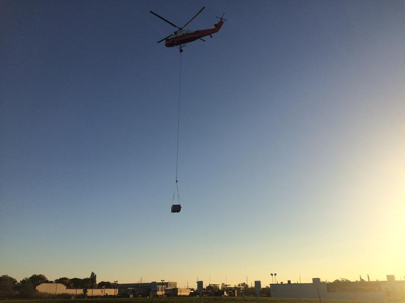 Helicopter lifts HVAC unit from roof of Heller Machine Tools