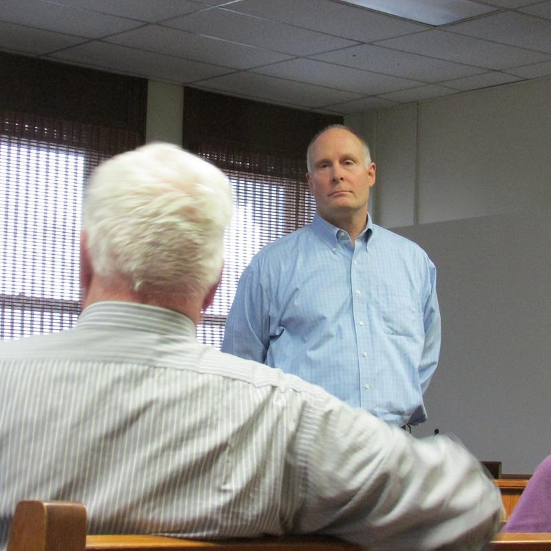 U.S. Rep. John Moolenaar, R-Midland, meets with people in Stanton, Michigan