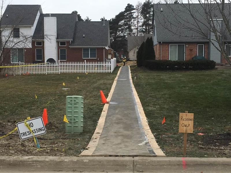Homes on Eberlein Rd. in Fraser were still restricted access on Friday. Most families displaced by the sinkhole should be able to move back next week.