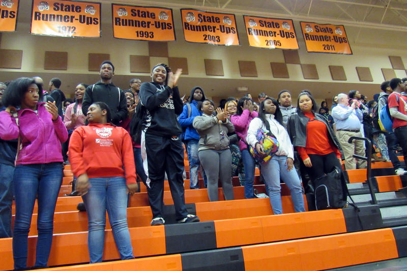 Students at Muskegon Heights join a community rally Monday in support of their school.
