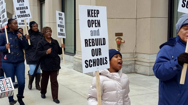Protestors urge state lawmakers to not close 25 low-performing Detroit schools.
