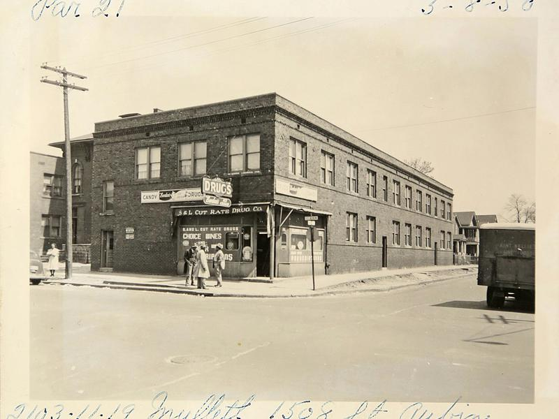 In this historical photo, a group stands outside of a drugstore on the corner of St. Aubin and Mullett streets on May 8, 1950 in Black Bottom, an area that was torn down in the 1950s to make way for the Chrysler Freeway and the Detroit Medical Center.