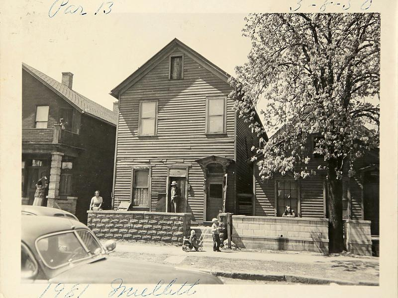 In this historical photo, neighbors enjoy their front porches on May 8, 1950 located at 1981 Mullett St. in Black Bottom,
