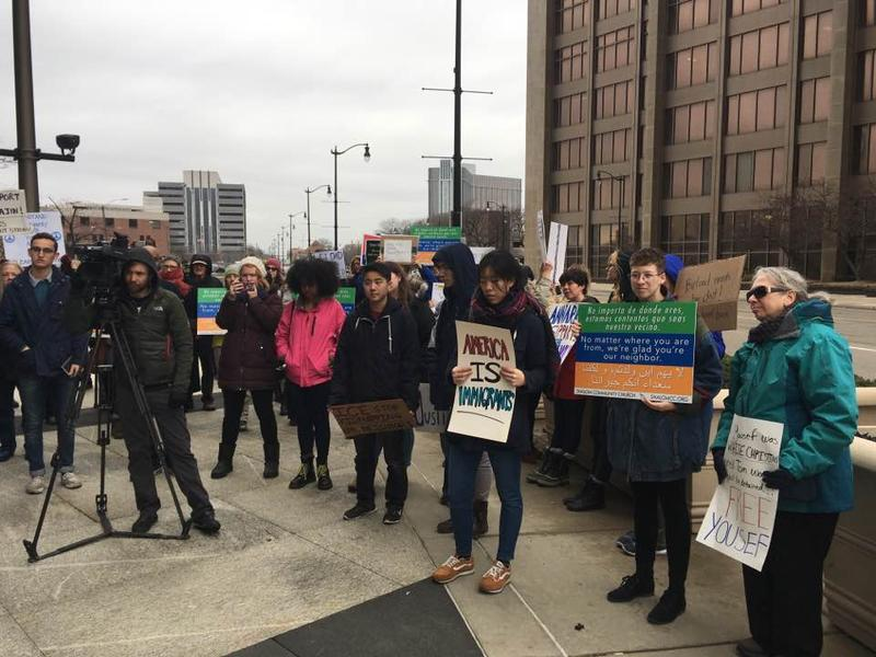Supporters rally for Yousef Ajin and family ahead of his deportation hearing in Detroit.