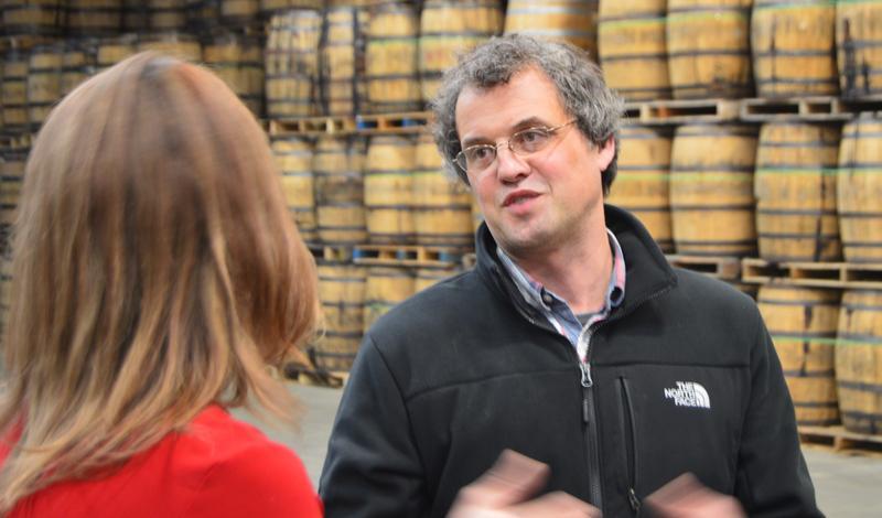 Rifino Valentine talking with Tammy Coxen at the Valentine distillery.