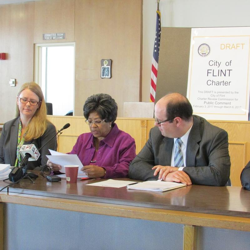 Members of the Flint Charter Review Commission release a draft of their recommeded changes to the document.