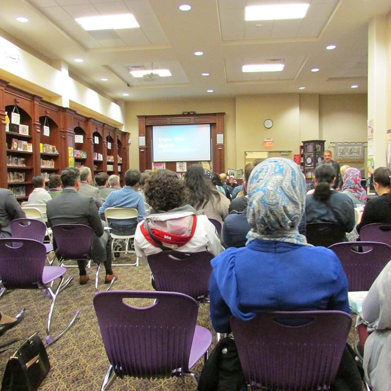 Dozens of people attend a meeting at the Flint Islamic Center.