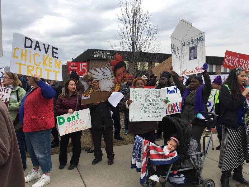 Constituents of Rep. Dave Trott protest at his office in Troy, demanding that the Congressman hold in-person town hall meetings.