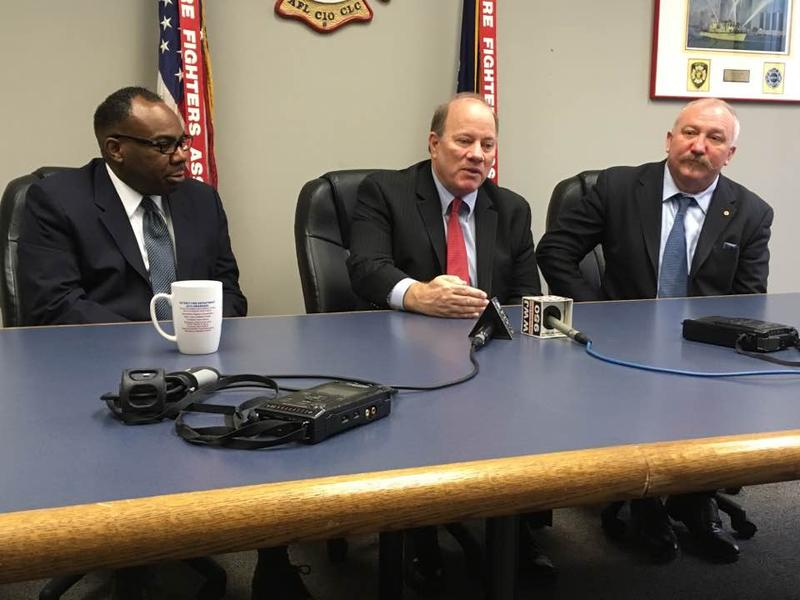 From left: Mark Young, head of the Detroit Police Lieutenants and Sergeants Association; Mayor Mike Duggan; and Detroit Firefighters Association President Mike Nevin.