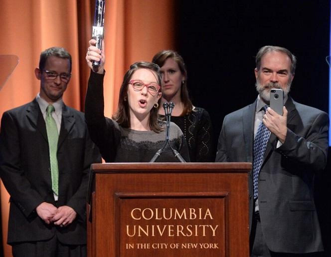 Lindsey Smith holds the duPont Silver Baton award accompanied by (l to r) Michigan Radio's Mark Brush, Rebecca Williams and Steve Carmody