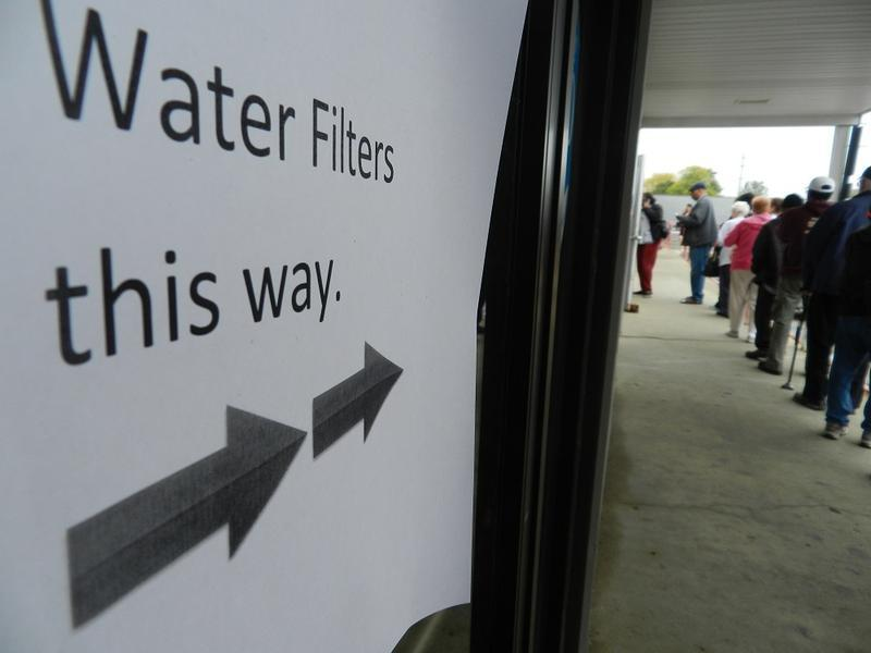 People in Flint waiting in line for water filters.