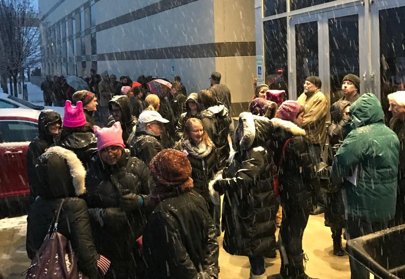 The crowd started to gather before dawn outside the Suburban Collection Showpplace in Novi.