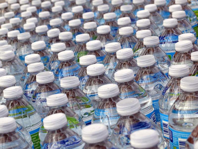 Cases of bottled water are distributed from nine sites located across Flint, manned by paid city residents.