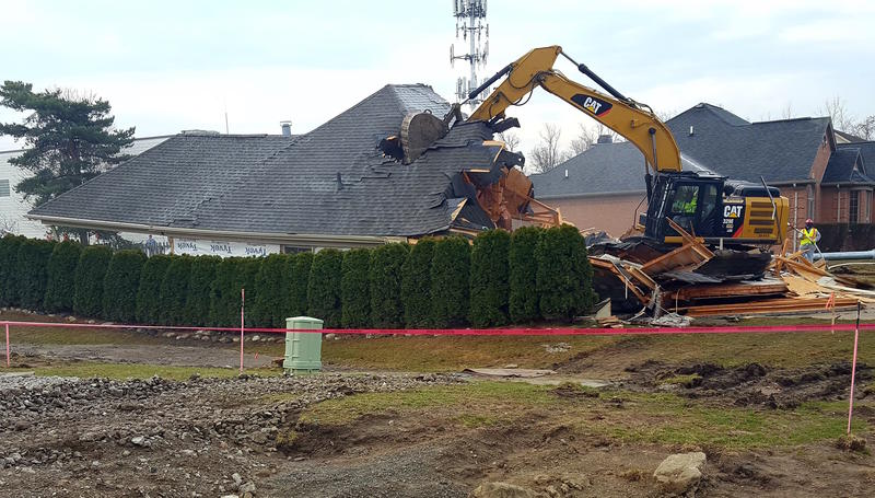 Home along 15 Mile Road in Fraser being torn down because of the sinkhole.