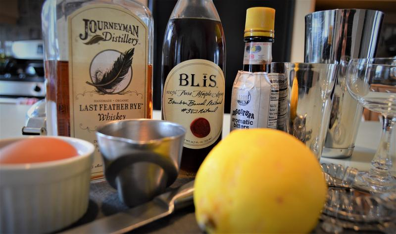 Ingredients for a whiskey sour using Michigan maple syrup.