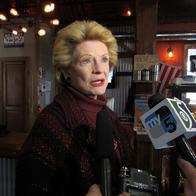 U.S Sen. Debbie Stabenow (D-MI)  talks to reporters inside a sporting goods store in Fenton.