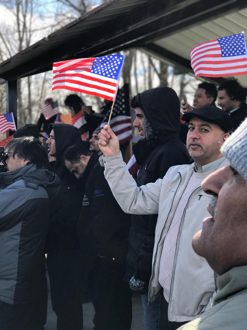 Protesters waved American flags and said the president's executive order and deportation of people living in the U.S. illegally contradicted American values.