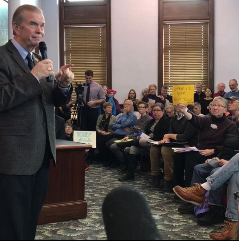 Congressman Tim Walberg addressed a sometimes disagreeable crowd at a packed town hall event in Hillsdale Friday.