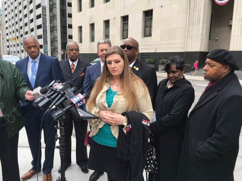 Melissa Mays, foreground, with members of Concerned Pastors for Social Action, speaks outside federal court in Detroit.