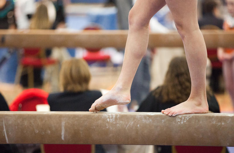lower half of gymnast on balance beam