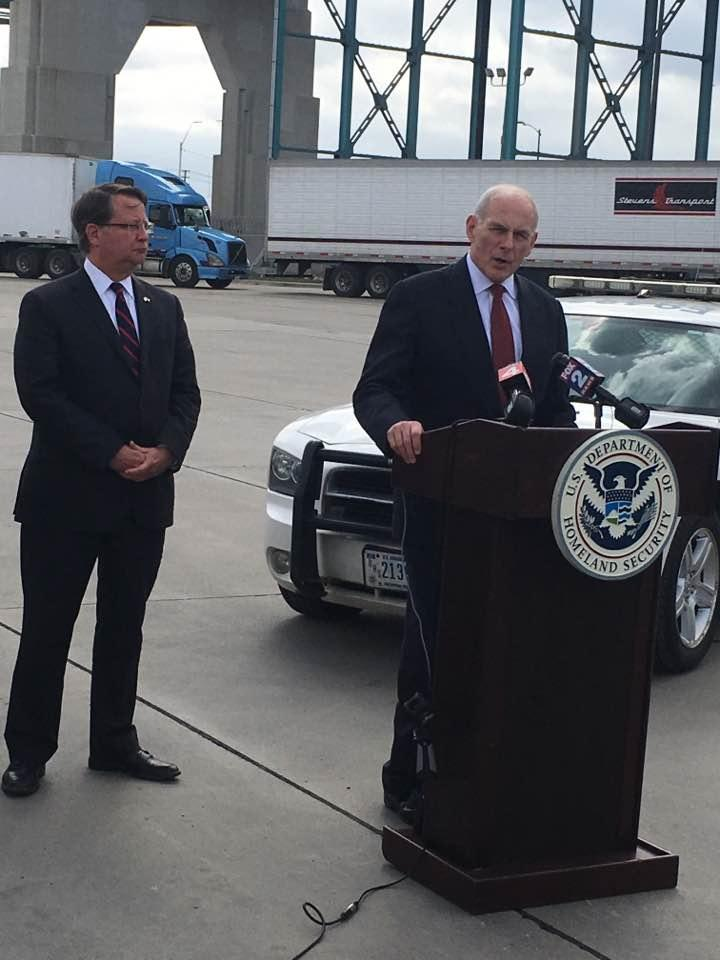 Homeland Security Secretary John Kelly, with Michigan Sen. Gary Peters, discuss Kelly's visit near Detroit's Ambassador Bridge.