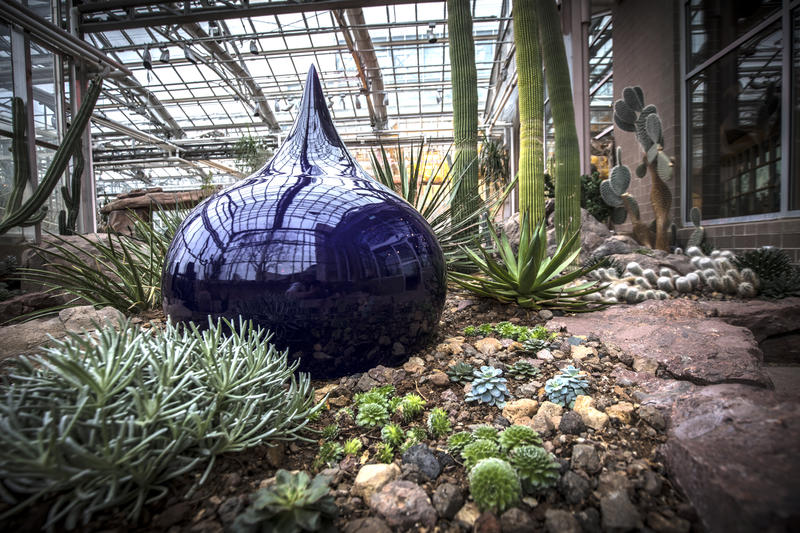 Water Drop, a Weiwei piece installed in a flower bed.