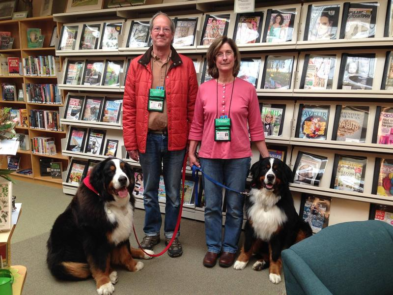 Zeb is the library dog at the Traverse Area District Library. He is pictured here with his handlers, Candy and Lee Gardner, and his late brother Ralphie.