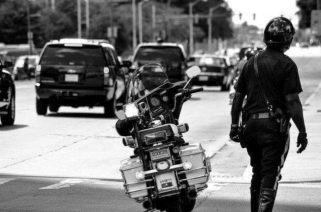A police officer with motorcycle.