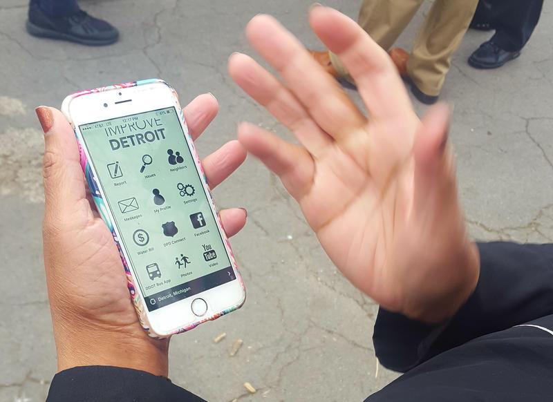 A Detroit resident uses the Improve Detroit mobile app.