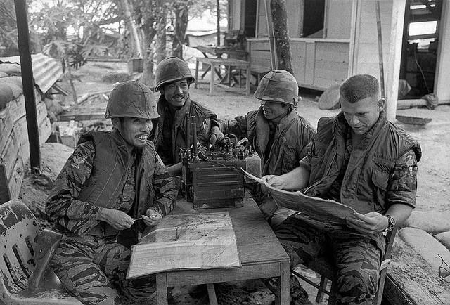 Four soldiers sit at a table in South Vietnam, 1972