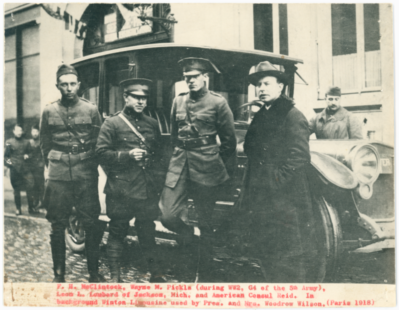 Freeman McClintock stands on the left, in front of a limousine used by President Woodrow Wilson. The photo was taken in Paris 1918.